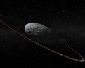 Recreación artística de Haumea y su anillo descubierto en 2017.