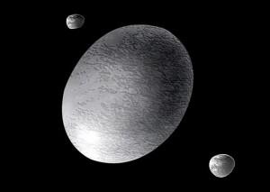 Recreación artística de Haumea y sus dos pequeñas lunas descubiertas en 2005.